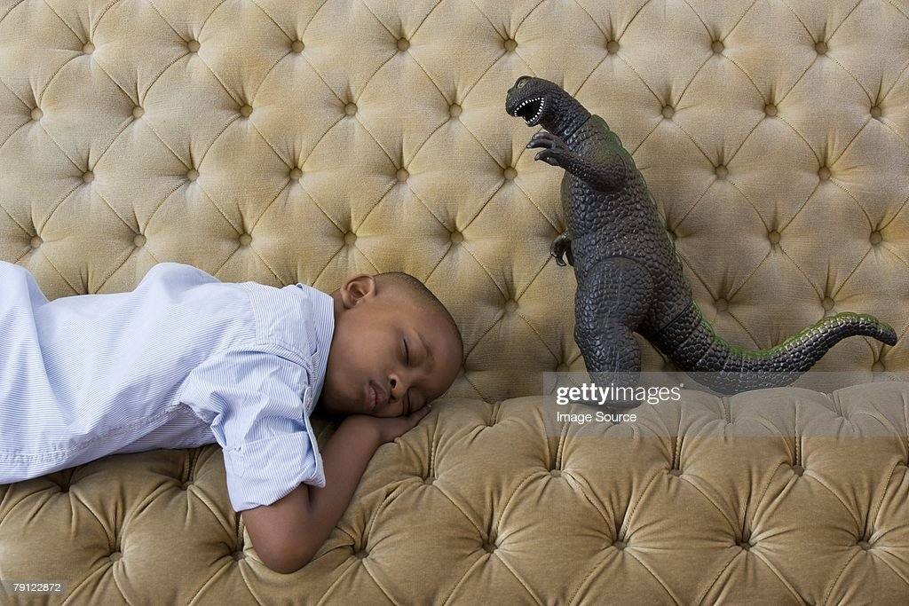 Toy monster and boy sleeping : Stock Photo