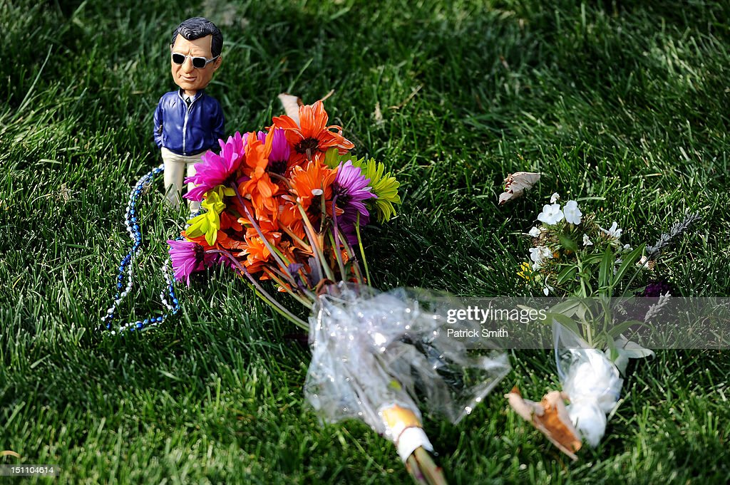 A toy of former Penn State football coach, Joe Paterno, sits in the grass at the former site of the Joe Paterno statue prior to the Penn State playing the Ohio Bobcats at Beaver Stadium on September 1, 2012 in State College, Pennsylvania.