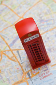 Toy phone booth on map of London