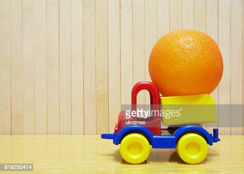 Toy plastic car with orange : Stock Photo
