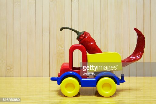 Toy plastic car with red pepper : Foto de stock