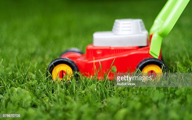 Toy plastic lawn mower