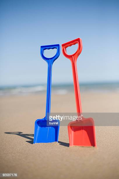 Toy Plastic Spades The Sand At A Beach In Summer