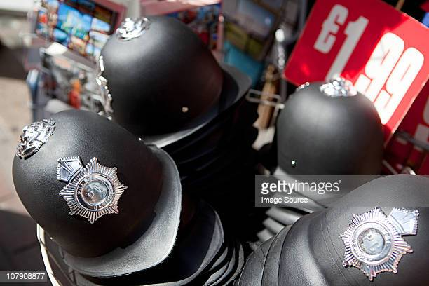 Toy police helmets for sale, London