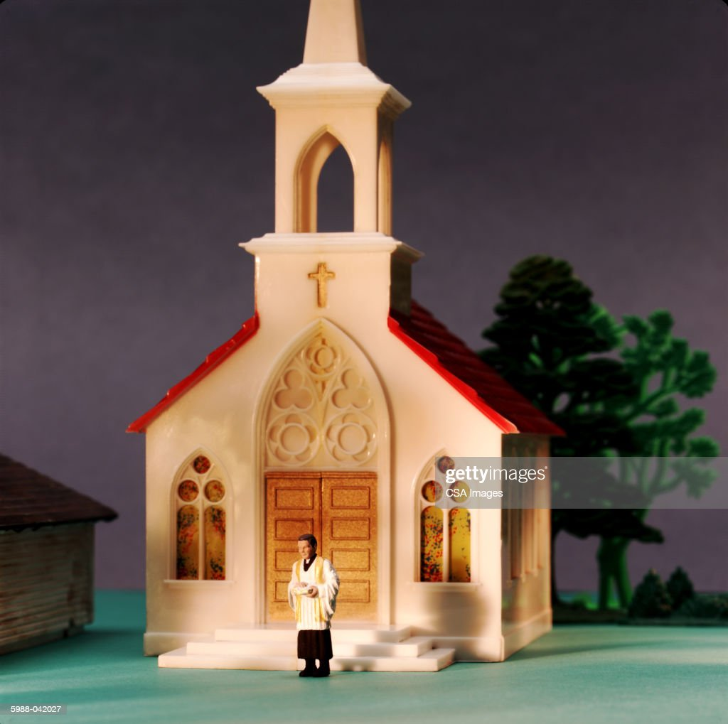 Toys For Church : Toy priest in front of church stock photo getty images