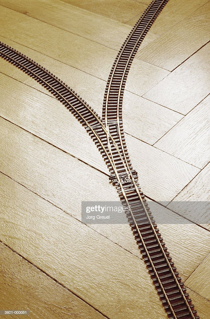 Toy Railroad Tracks on Floor