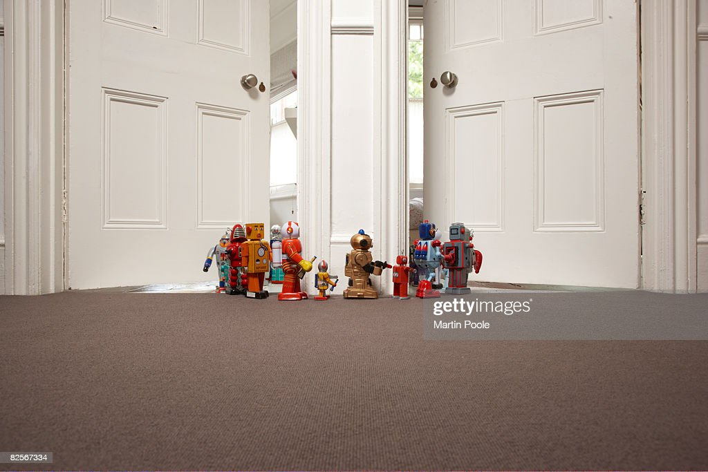 toy robots going from one room to another