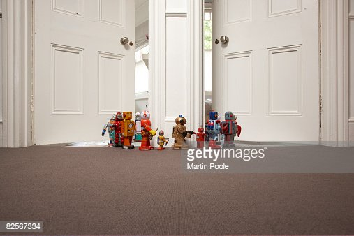 toy robots going from one room to another : Stock Photo