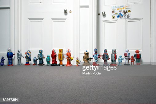 toy robots lined up outside childs bedroom