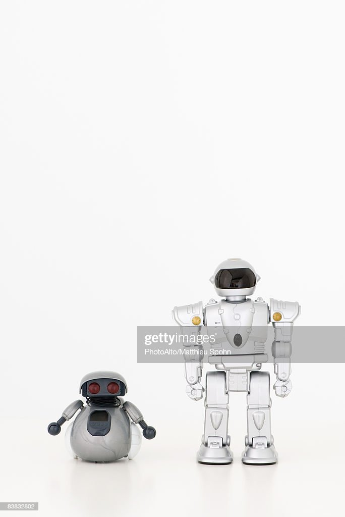 Toy robots looking at camera, side by side