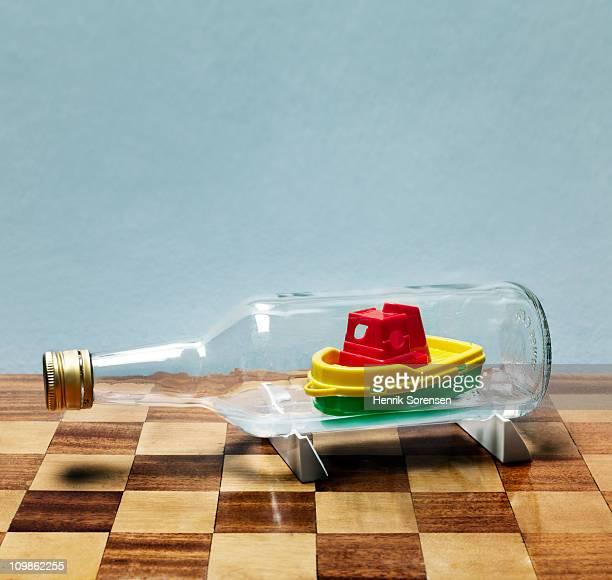 Toy ship floating inside a glass bottle