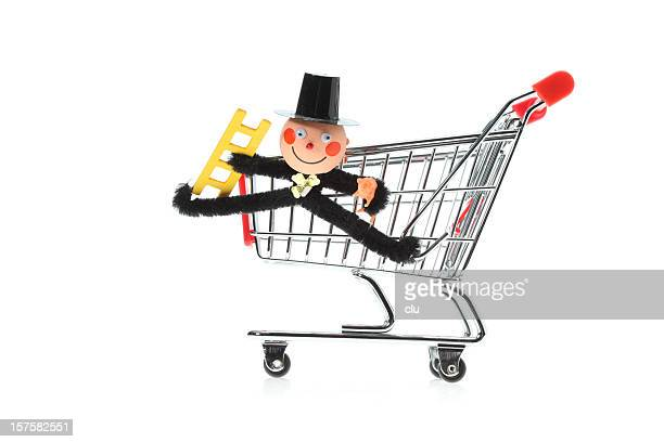 Toy shopping cart side view with chimney sweeper