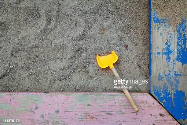 Toy shovel in a sandbox