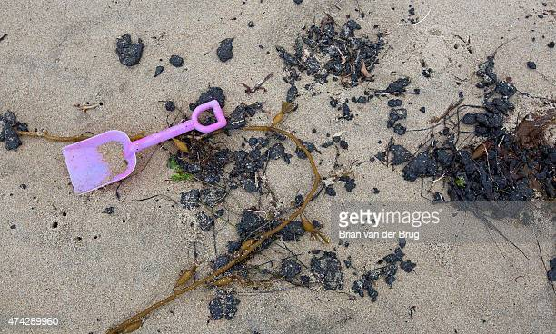 A toy shovel lies among globs of oil on the sand at El Capitan State Beach on May 21 2015 near Santa Barbara California State officials have closed...