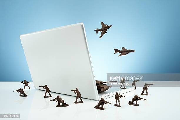Toy soldiers in a 'firewall' around laptop