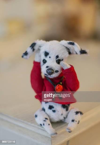 Toy Teddy Dog Dalmatian sitting on a white dresser