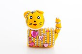 Toy tiger decorated with stick-on jewels