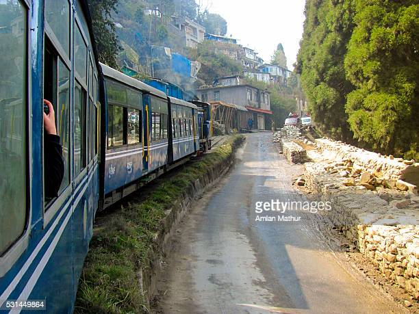 Toy train (himalayan railway) crossing rural areas