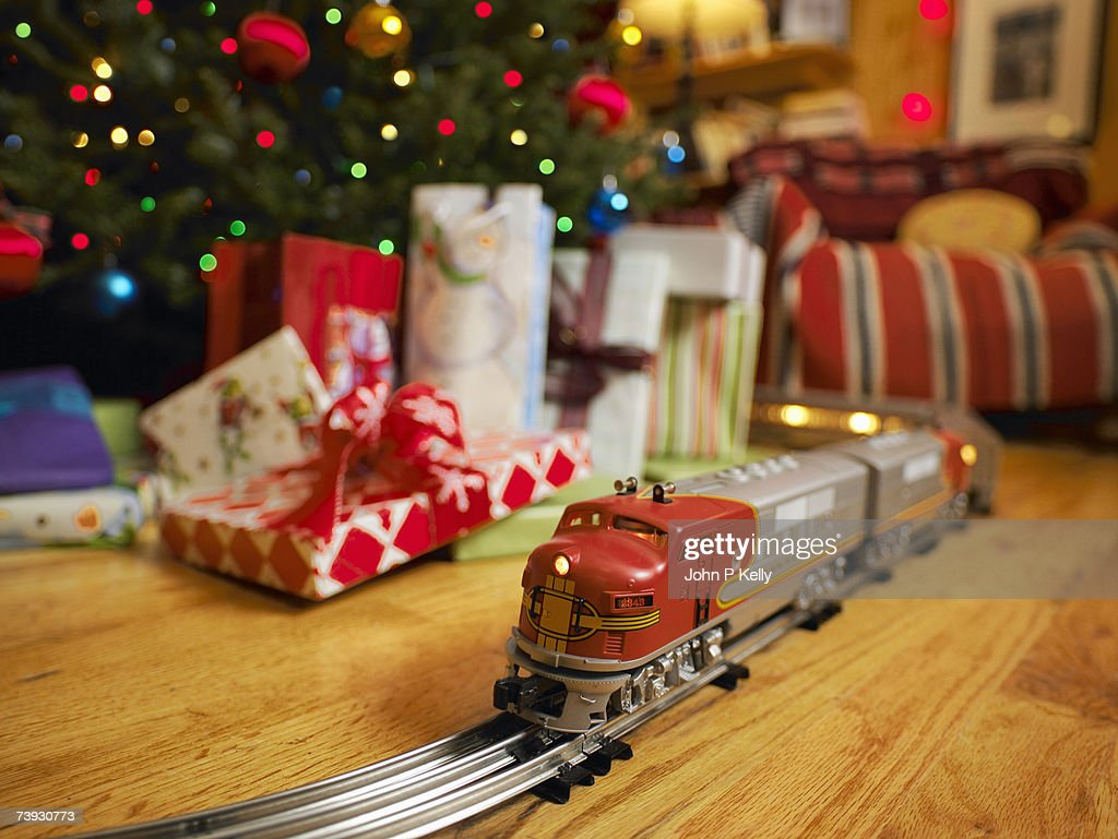 toy train on track going around christmas tree stock photo - Train For Around Christmas Tree