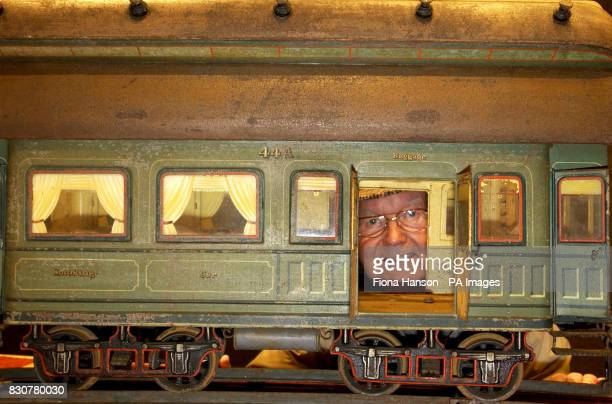 Toy train set collector Donald Mckay from Twickenham Middlesex peers through the baggage car of a1906 Marklin gauge V train which was sold at the...