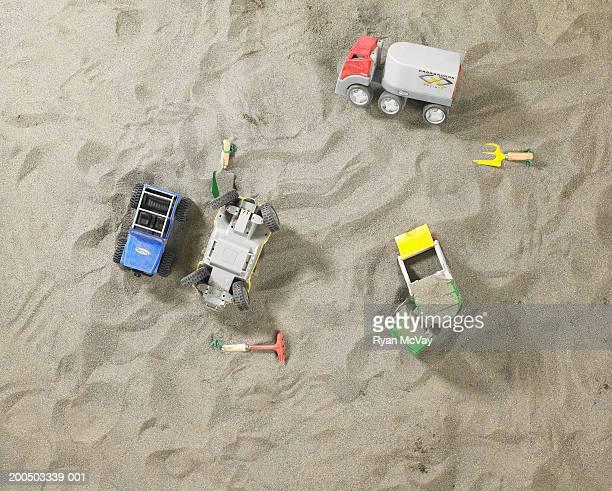 Toy trucks in sandbox, overhead view