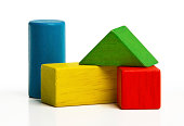toy wooden blocks, multicolor building construction bricks over white background.