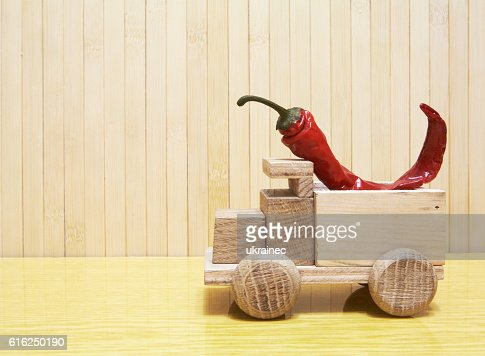 Toy wooden car with red pepper : Foto de stock