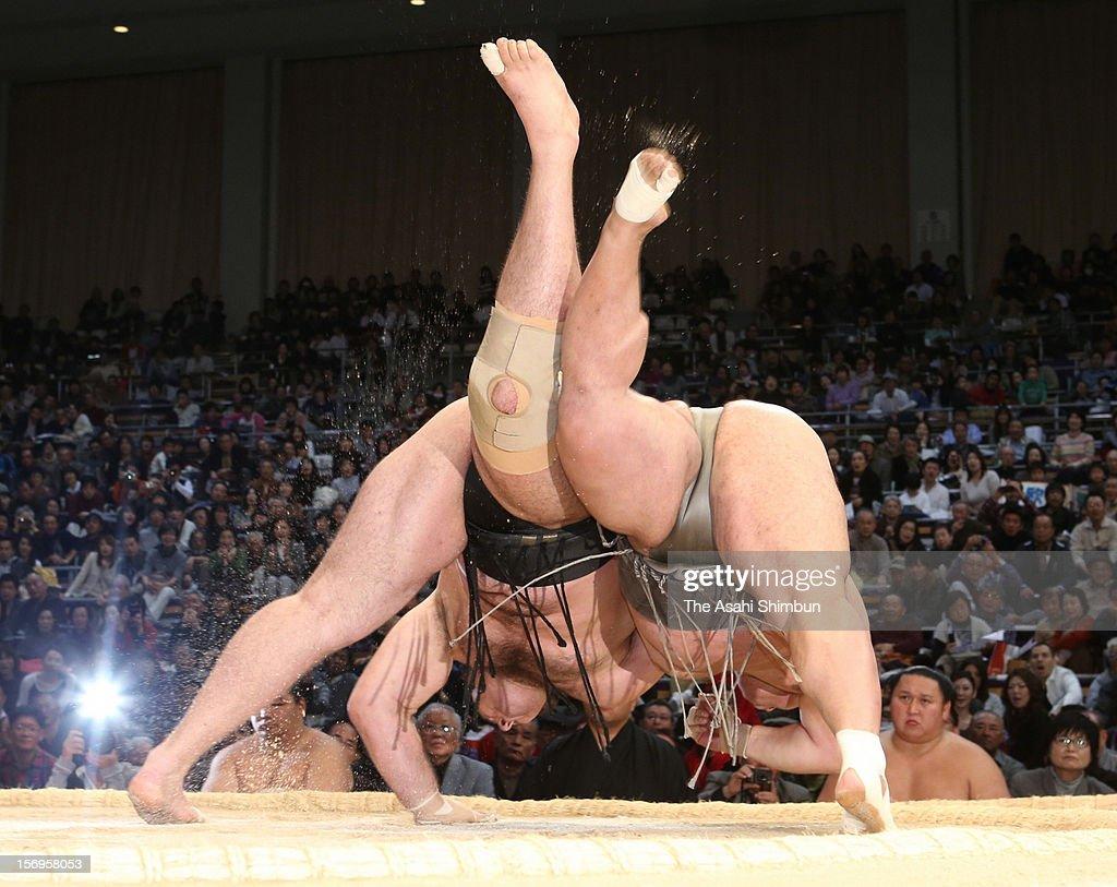 Toyonoshima (R) throws Bulgarian Ozeki Kotooshu (L) to win during day fourteen of the Grand Sumo November Tournament at Fukuoka Convention Center on November 24, 2012 in Fukuoka, Japan.