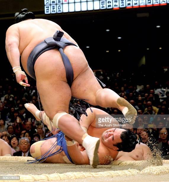 Toyonoshima throws ozeki Kotoshogiku to win during day thirteen of the Grand Sumo New Year Tournament at Ryogoku Kokugikan on January 22 2016 in...