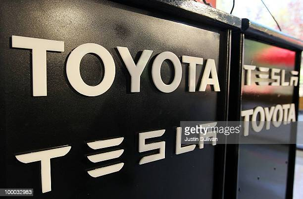 Toyota and Tesla Motors logos appear on a podium before a news conference at Tesla Motors headquarters May 20 2010 in Palo Alto California Electric...
