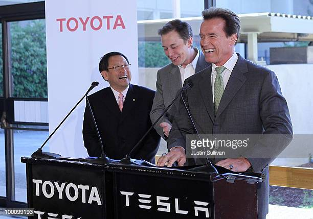 Toyota CEO Akio Toyoda Tesla Motors CEO Elon Musk and California governor Arnold Schwarzenegger laugh during a news conference at Tesla Motors...