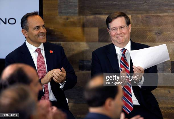 Toyota CEO Jim Lentz and Kentucky Governor Matt Bevin applaud a speaker at the unveiling of a new Toyota engineering headquarters October 30 2017 in...