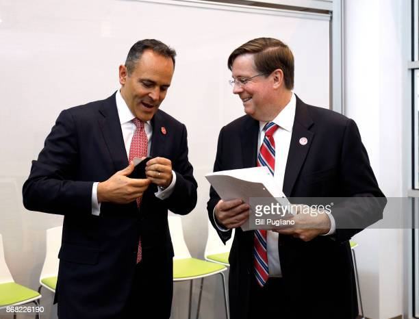 Toyota CEO Jim Lentz and Kentucky Governor Matt Bevin wait to speak at the unveiling of a new Toyota engineering headquarters October 30 2017 in...