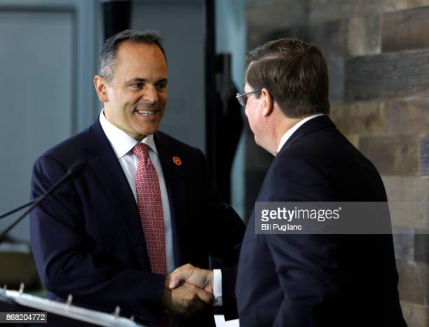 Toyota CEO Jim Lentz shakes hands with Kentucky Governor Matt Bevin at the unveiling of a new $80 million Toyota engineering headquarters October 30...