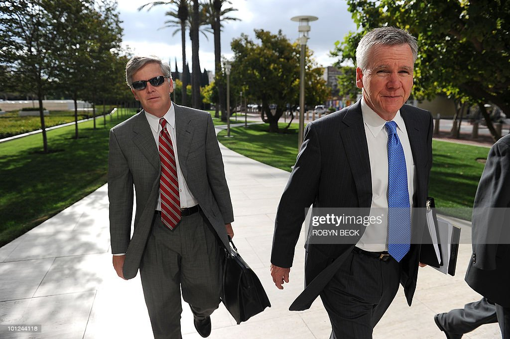 Toyota defense attorneys Joel Smith (L) and Vince Galvin (R) arrive for a scheduling hearing at US District Court in Santa Ana, California on May 28, 2010. Toyota is facing one of the largest consolidated class-action cases in US history, combining more than 300 state and federal suits concerning acceleration defects in Toyota vehicles.