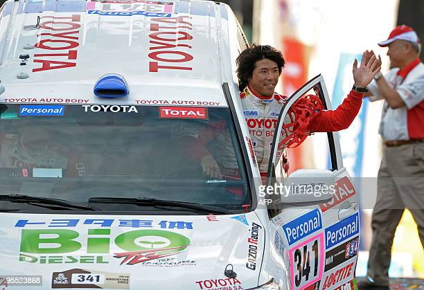 Toyota driver Jun Mitsuhashi of Japan waves at the symbolic start of the Rally Dakar 2010 in Buenos Aires on January 1 2010 The 2010 Dakar would take...