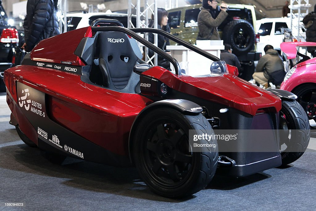 Toyota Engineering Society's (TES) Minute-S one-rider, three-wheeled hybrid vehicle is displayed at the Tokyo Auto Salon 2013 at Makuhari Messe in Chiba, Japan, on Friday, Jan. 11, 2013. The Tokyo Auto Salon runs until Jan. 13. Photographer: Kiyoshi Ota/Bloomberg via Getty Images