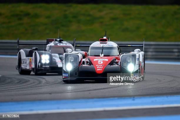 Toyota Gazoo Racing Number 5 with Drivers Anthony Davidson and Sebastien Buemi and Kazuki Nakajima and Porsche Team Car Number 2 with drivers Romain...