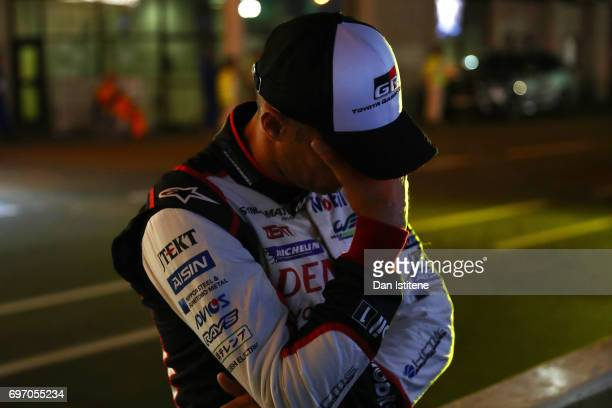 Toyota Gazoo racing's Stephane Sarrazin reacts on the pit wall to the news that car number 9 has also encountered problems and stopped on track...