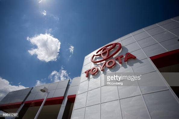 Toyota logo hangs outside Mountain State Toyota in Denver Colorado US on Friday July 3 2009 Toyota Motor Corp grappling with excess North American...