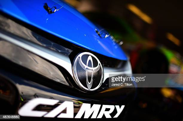 Toyota logo is seen on the car of Clint Bowyer driver of the Maxwell House Toyota in the garage during practice for the NASCAR Sprint Cup Series...