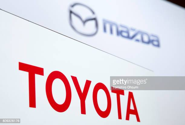 Toyota Motor Co and Mazda Motor Co logos are seen during a joint press conference with on August 4 2017 in Tokyo Japan Toyota and Mazda announced to...