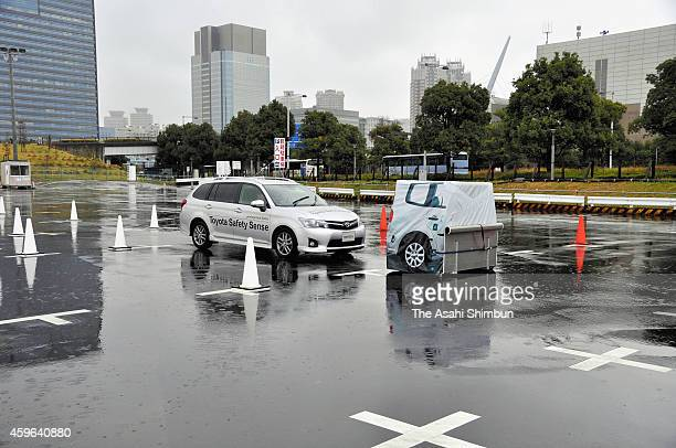 Toyota Motor Co demonstrates their automatic braking systems on November 26 2014 in Tokyo Japan Toyota plans to commercialize by 2017 cars equipped...