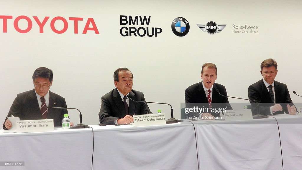 Toyota Motor Co director and senior managing officer Yasumori Ihara, vice chairman Takeshi Uchiyamada, BMW development chief Herbert Diess and senior vice president Klaus Froehlich attend during a press conference on January 24, 2013 in Nagoya, Aichi, Japan. Toyota Motor Corp. and BMW Group will start joint research on 'lithium-air batteries,' which are expected to outperform the lithium-ion batteries currently used in plug-in gas-electric hybrid and other vehicles.