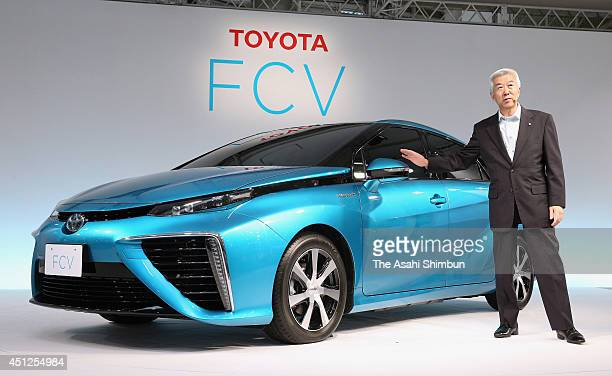 Toyota Motor Co Excutive Vice President Mitsuhisa Kato introduces the new hydrogen fuelcell sedan during its unveiling on June 25 2014 in Tokyo Japan...