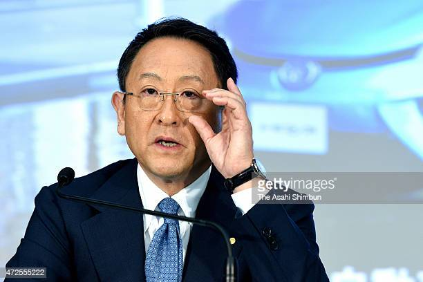 Toyota Motor Co President Akio Toyoda adjusts his glasses during the press conference announcing the fiscal 2014 financial result at Toyota's Tokyo...