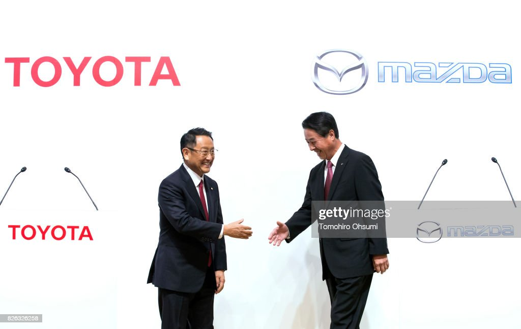 Toyota Motor Co. President Akio Toyoda, left, and Mazda Motor Co. President and CEO Masamichi Kogai, right, shake hands during a photo session at a joint press conference on August 4, 2017 in Tokyo, Japan. Toyota and Mazda announced to form a partnership establishing a joint venture that produce vehicles in the United States and jointly developing technologies for electric vehicles.