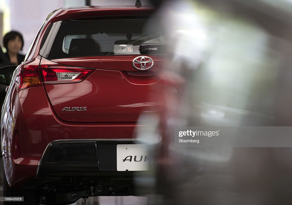 A Toyota Motor Corp. Auris compact vehicle is displayed at the company's head offices in Tokyo, Japan, on Monday, Nov. 5, 2012. Toyota Motor Corp., Asia's biggest carmaker, raised its full-year profit forecast as rising demand for the Prius hybrid in the U.S. and Japan helped make up for slumping sales in China. Photographer: Tomohiro Ohsumi/Bloomberg via Getty Images