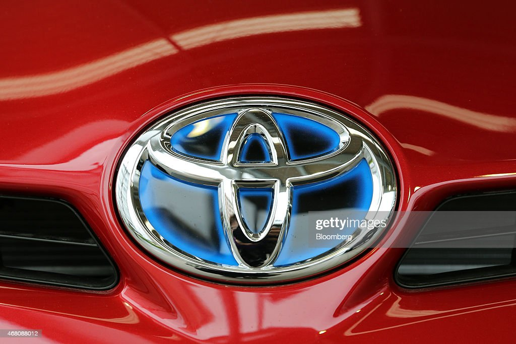 A Toyota Motor Corp badge is seen on the company's Prius hybrid vehicle outside one of the the company's Netz dealership in Toyota City Aichi...
