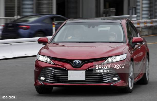 A Toyota Motor Corp Camry hybrid vehicle is taken for a test drive at the Toyota Mega Web showroom in Tokyo Japan on Tuesday Aug 1 2017 Toyota is...